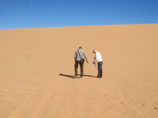 My wife and brother-in-law making their way up a dune in Utah's Coral Pink Sand Dunes State Park