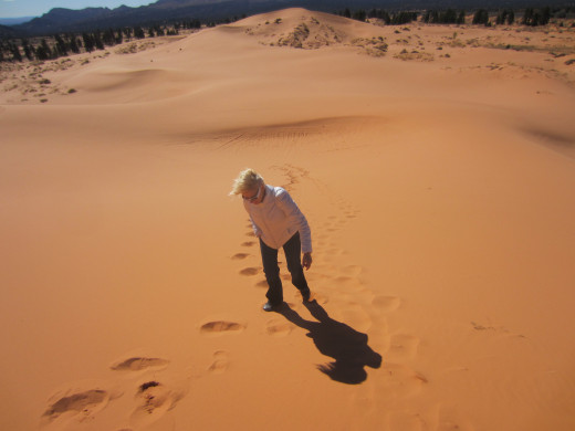 My wife making her way up a large sand dune in  Utah's Coral Pink Sand Dunes State Pk