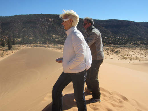 My wife and brother-in-law on top of a dune in Utah's Coral Pink Sand Dunes State Park