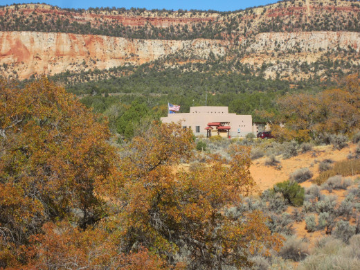 Visitor center at  Utah's Coral Pink Sand Dunes State Park as seen from one of the sand dunes.