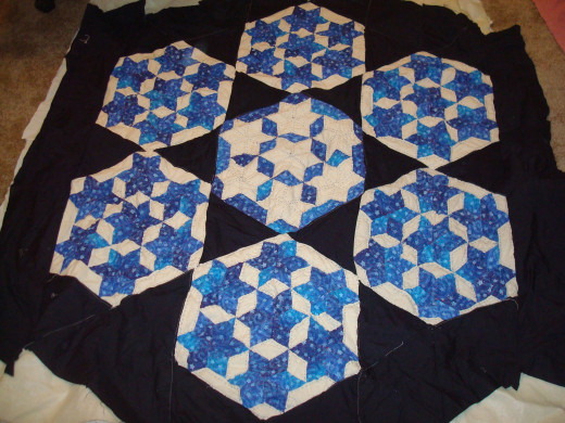 seeing my quilt this made me realize it really is almost done,thank you Chocolate Lady for getting me inspired again!
