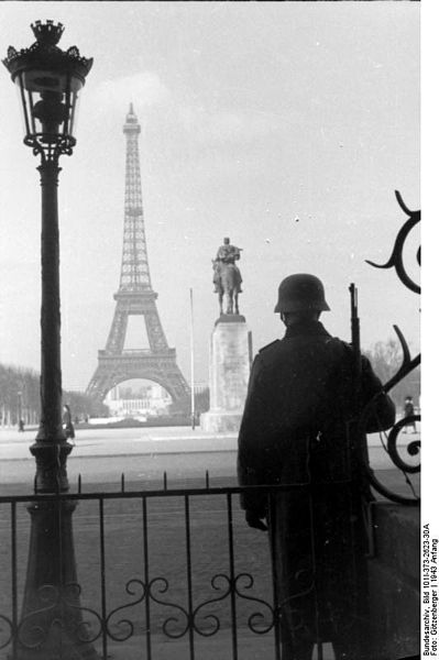 Paris, January 1943. German soldier in front of the Eiffel tower
