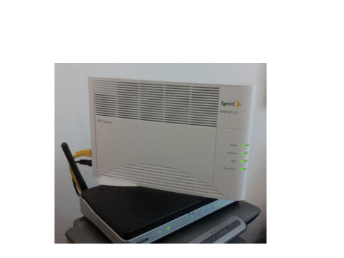 Our Sprint Airave mounted on top of our wireless router