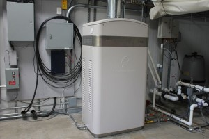 A ClearEdge Power Home Fuel Cell Sitting In A Home's Utility Room