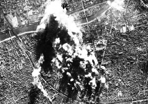 Photograph made from B-17 Flying Fortress of the 8th AAF Bomber Command on 31 Dec. 1943 when they attacked the vital CAM ball-bearing plant and the nearby Hispano Suiza aircraft engine repair depot in Courbevoie near Paris, France.