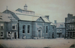 Photograph of North side of Market Place, Aylesham, Norfolk in 1857. Location of the Town Hall .
