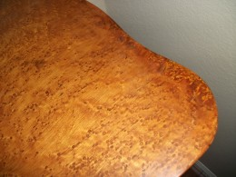 Faux painted touch-up. Broken edges of natural wood has darken with age.