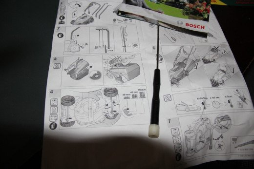 Instruction manual booklet for connecting the parts and using the Bosch Lawnmower in the garden