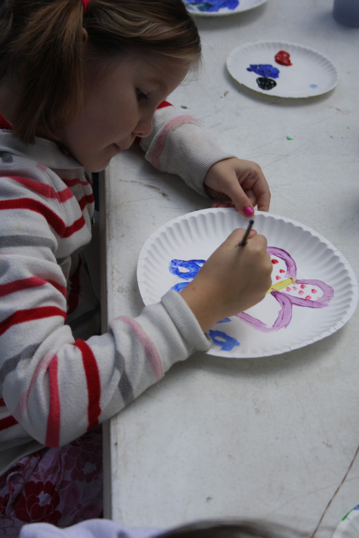 Painting a plate.