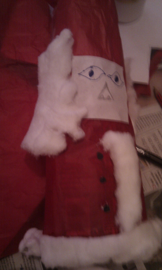 Glue on the face and finish with cotton wool