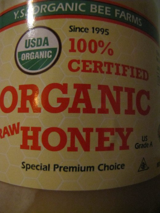 Raw honey that's 100 percent pure looks, smells and tastes much different than many commercial varieties of honey, which may contain unhealthy additives or contaminants.