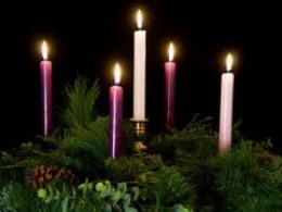 The fifth white candle on Christmas Eve