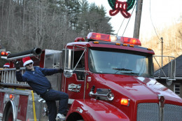 Me hanging from our truck at last years parade. I live for these moments.
