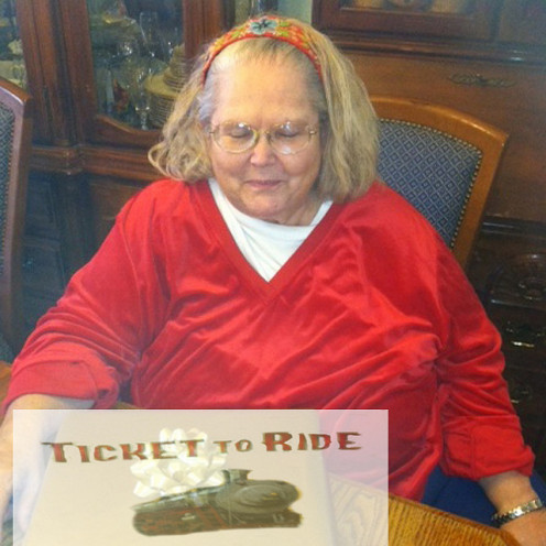 "See how disappointed this woman is? She just received a lame gift from a ""Slacker Santa."""