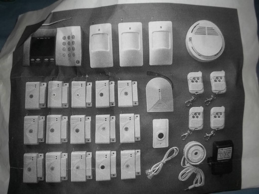 Our home security system included a keypad and A/C adapter, 15 sensors for doors or windows, a panic button, 3 motion detectors, 1 smoke alarm, 4 key chains remotes, a glass break detector, and a 120 decibal alarm.