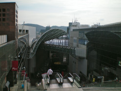 The ultra modern Kyoto station contrasts with its classical past (c) A Harrison