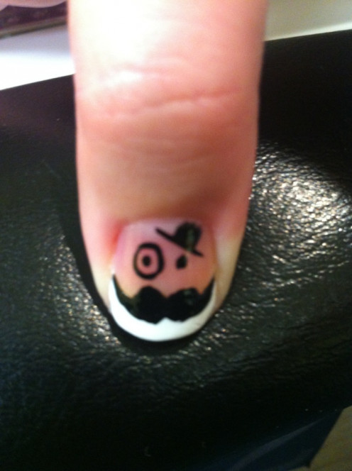 Mustache and top hat nail art done by Lieu