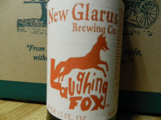 Laughing Fox bottle label by New Glarus Brewing Company.
