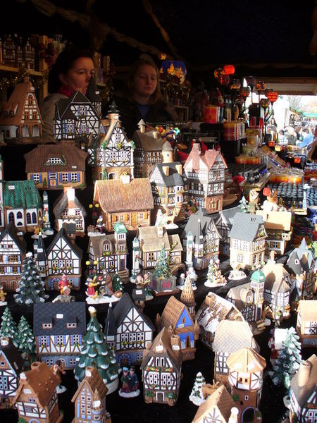 Southampton Christmas Market Stall of colourful china buildings from Germany, most of which are incense burners