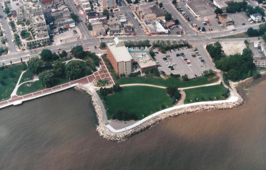 Spencer Smith Park opposite Brant St., July 1995, Burlington Canada. Note that the coloured impressed asphalt walkway along the waterfront (left side) has just been completed.