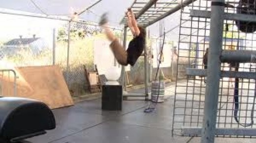 Hanging leg raises, toes to bar