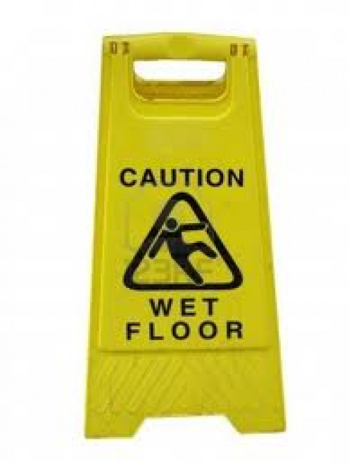 A Wet Floor sign is a good way to prevent slip and falls. It is commonly used in produce departments and other areas of a grocery store.