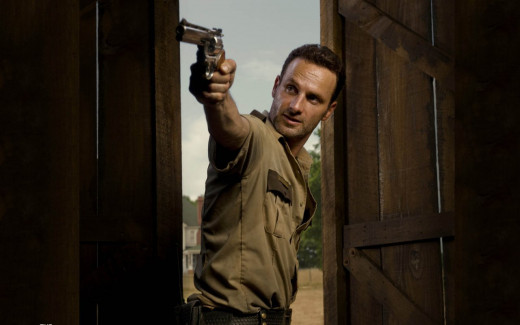 rick of walking dead pointing gun