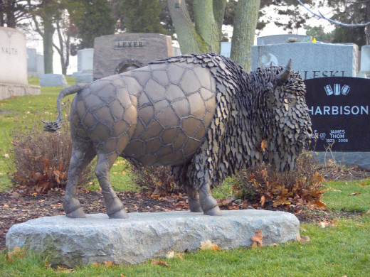 One of many decorative markers throughout the cemetery.  Notice the detail of the bronze buffalo.