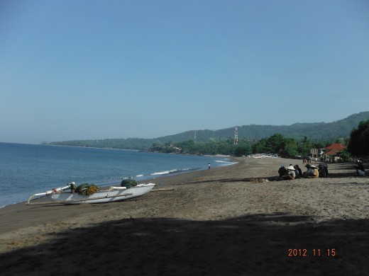 Sengigi beach. Some fishermen waited for the fishing boat to arrive at the beach.