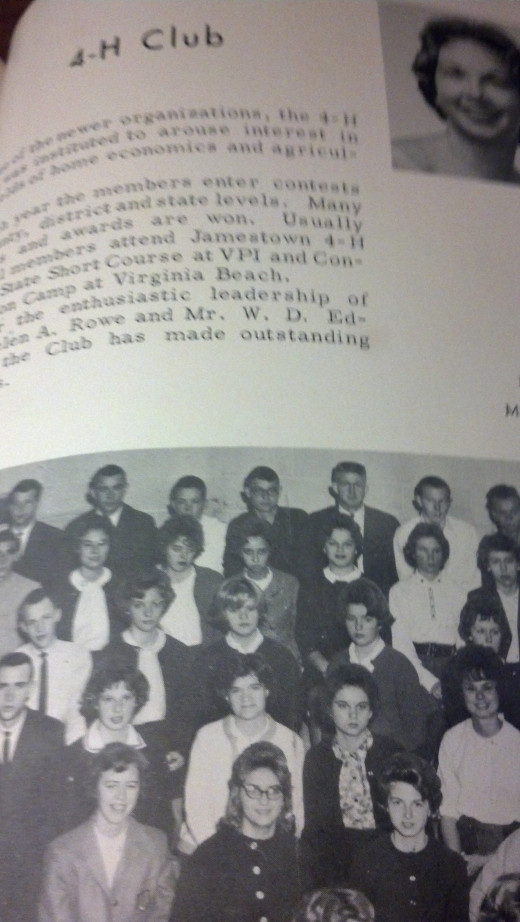 I am in the center  on the second row in the white sweater.