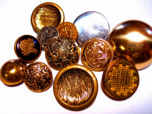 Pretty metallic buttons and those with a leather look to them can dress up an outfit in an inexpensive way.