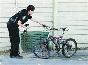 Police officer and damaged bicycle