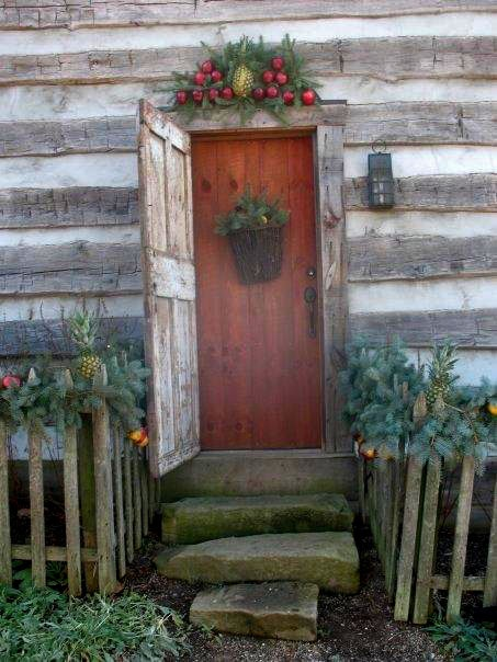 Cabin with Christmas greenery & fruit