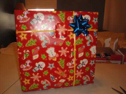 Add a bow and name tag and your done.  I recommend always tagging your gifts immediately, since sometimes which package is which may get confusing once many are wrapped.