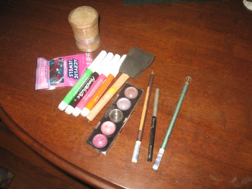 In addition to Face Paints, I use FoodWriters, foundation, eyeshadow, eyeliner pencils, powder, and acrylic jewels.