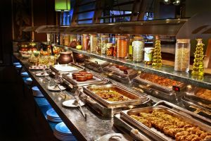 Buffett style eating is not always mindful, especially when the restaurant is busy. Patrons often rush through and gorge.