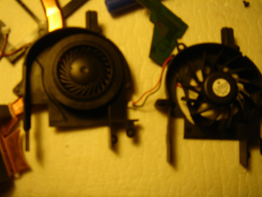 A new laptop fan (right) replacing the one with noise (left).