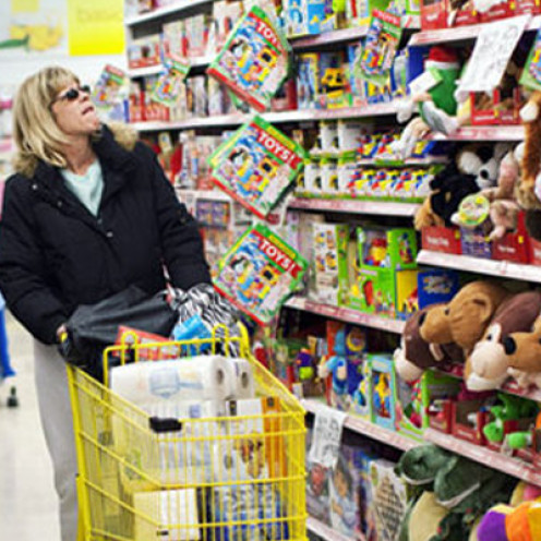 A mother shopping for toys