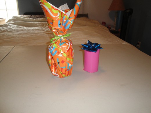 There are two ways to wrap a cylinder.  These styles will also work for a tall rectangle, and the style shown with orange paper will work great for bottles.