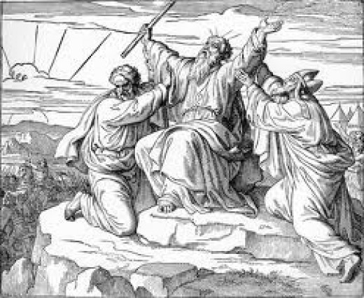Aaron and Hur lifting the arms of Moses.