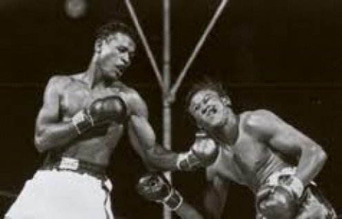 Sugar Ray Robinson Knocks Gene Fullmer cold with a beautiful left hook to regain the middleweight Championship.