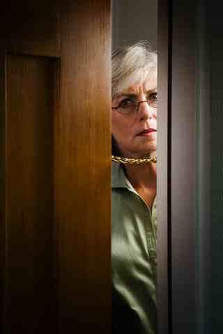 suspicious woman opening front door public domain