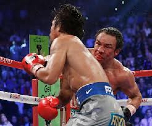 juan Manuel Marquez knocks out Manny Pacquiao in their fourth bout with a counter right. Both boxers were floored earlier in the bout.