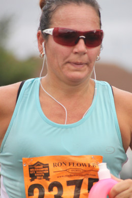Music can help with rhythm but sometimes you need to ditch the headphones and mix up your running pace for a faster 10k
