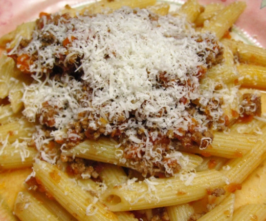 Penne with meat sauce and Parmesan cheese