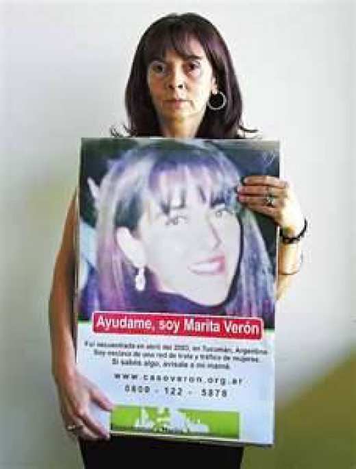 Susan Trimarco with her daughter's missing poster