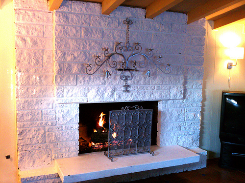 Can't work this cinder block fireplace into your décor? Creating an updated surround will solve your design dilemma!