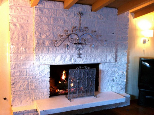 Can't work this cinder block fireplace into your decor? Creating an updated surround will solve your design dilemma!