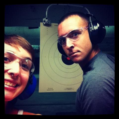Young adults at the gun range practicing self defense shooting techniques