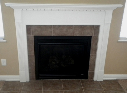 This fireplace could use a thicker mantel and wider pilasters.